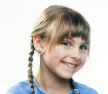 Young Girl with Pigtails Grinning